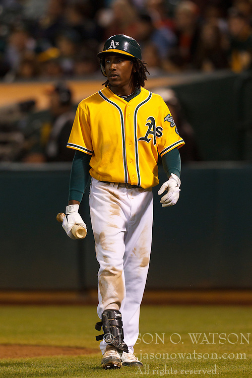 August 15, 2011; Oakland, CA, USA;  Oakland Athletics second baseman Jemile Weeks (19) returns to the dugout after striking out against the Baltimore Orioles during the seventh inning at O.co Coliseum.