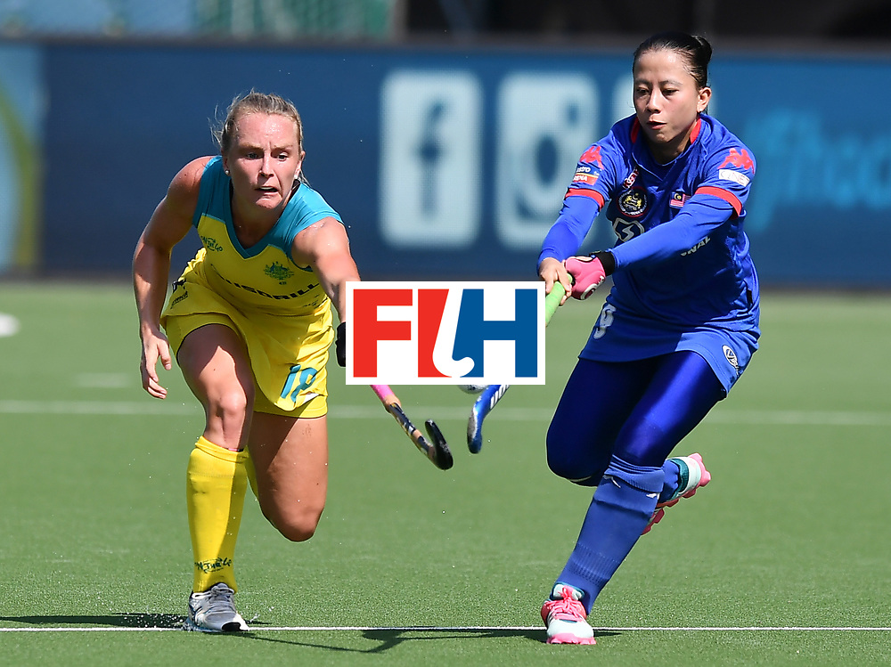 BRUSSELS, BELGIUM - JUNE 21: Jane Claxton (L) of Australia and Norbaini Hashim (R) of Malaysia during the FINTRO Women's Hockey World League Semi-Final Pool B game between Australia and Malaysia on June 21, 2017 in Brussels, Belgium. (Photo by Charles McQuillan/Getty Images for FIH)