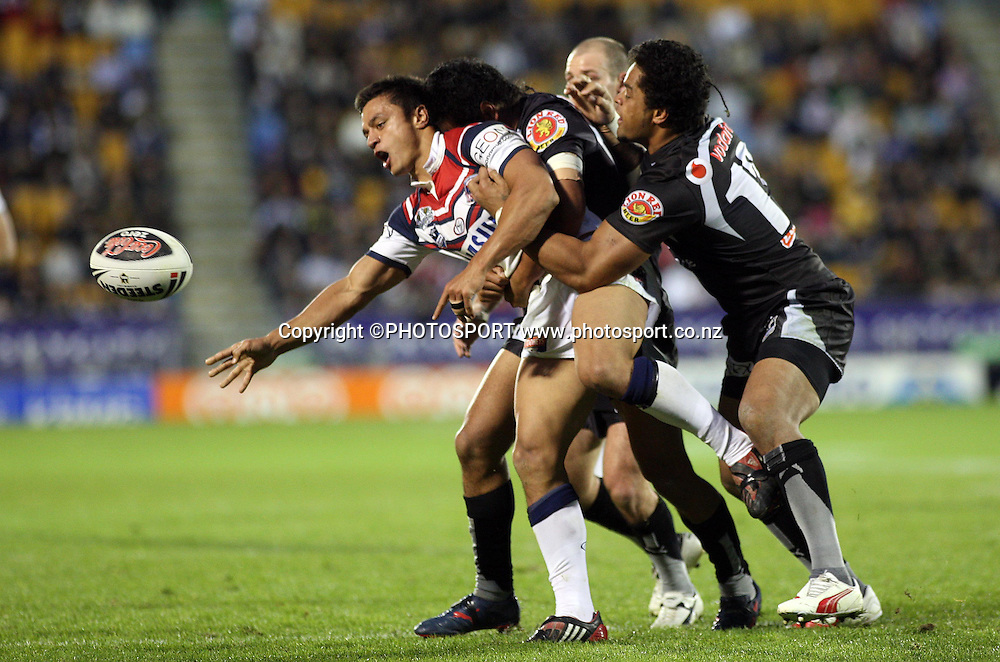 Roosters Sam Perrett is tackled by Patrick Ah Van and Epalahame Lauaki.<br />