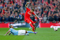 Alberto Moreno of Liverpool is brought down by Fernandinho of Manchester City - Mandatory byline: Rogan Thomson/JMP - 28/02/2016 - FOOTBALL - Wembley Stadium - London, England - Liverpool v Manchester City - Capital One Cup Final.