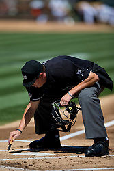 OAKLAND, CA - SEPTEMBER 07:  MLB umpire Cory Blaser #89 brushes off home plate during the first inning between the Oakland Athletics and the Houston Astros at O.co Coliseum on September 7, 2014 in Oakland, California. The Houston Astros defeated the Oakland Athletics 4-3.  (Photo by Jason O. Watson/Getty Images) *** Local Caption *** Cory Blaser