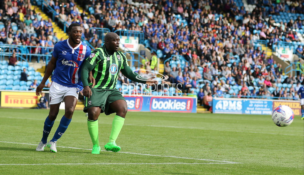 Adebayo Akinfenwa during the Sky Bet League 2 match between Carlisle United and AFC Wimbledon at Brunton Park, Carlisle, England on 22 August 2015. Photo by Stuart Butcher.