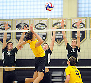 Pennridge's Josiah Friesen #36, Aaron Nelson #20 and Cross Edwards #14 await a volley from Central Bucks West's Karl Williams (center) during a volleyball match at Central Bucks West Monday May 2, 2016 in Doylestown, Pennsylvania.  (Photo by William Thomas Cain)