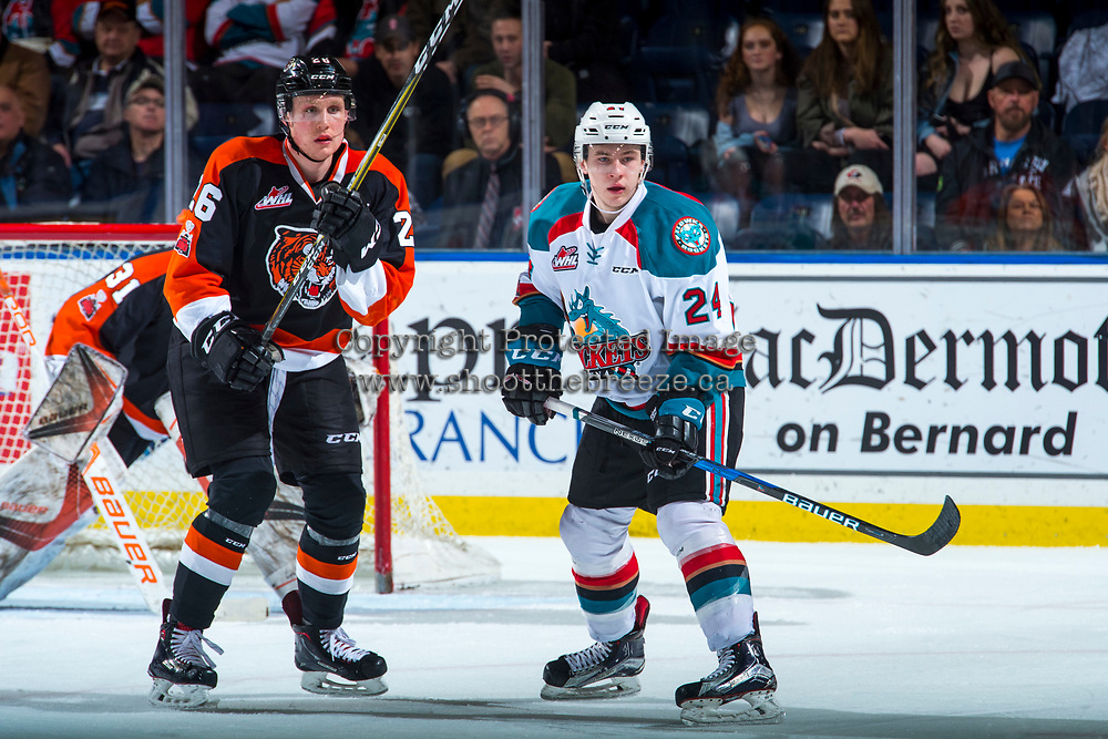 KELOWNA, CANADA - JANUARY 30: Dalton Gally #26 of the Medicine Hat Tigers and Kyle Topping #24 of the Kelowna Rockets look for the pass in front of the net on January 30, 2017 at Prospera Place in Kelowna, British Columbia, Canada.  (Photo by Marissa Baecker/Shoot the Breeze)  *** Local Caption ***