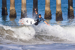 Jorgann Couzinet (FRA) advances to Round 3 of the 2018 VANS US Open of Surfing after placing second in Heat 10 of Round 2 at Huntington Beach, California, USA.