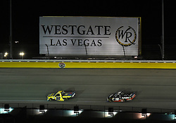 September 14, 2018 - Las Vegas, NV, U.S. - LAS VEGAS, NV - SEPTEMBER 14: Grant Enfinger (98) Champion Power Equipment, Curb Records Curb Racing Ford F-150 leads Noah Gragson (18) Safelite Auto Glass Kyle Busch Racing Toyota Tundra into turn two during the NASCAR Camping World Truck Series Playoff Race World of Westgate 200 on September 14, 2018, at the Las Vegas Motor Speedway in Las Vegas, NV. (Photo by Chris Williams/Icon Sportswire) (Credit Image: © Chris Williams/Icon SMI via ZUMA Press)