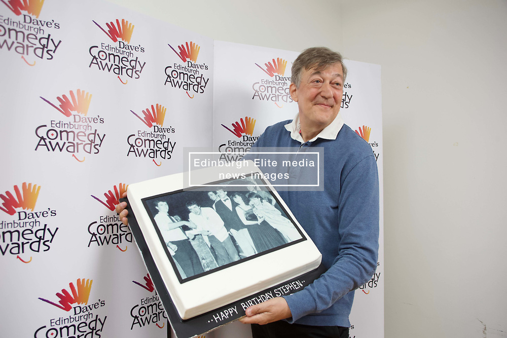 Stephen Fry, winner of the Edinburgh Comedy Award in 1981, with a cake presented to him on his birthday at this year's ceremony. pic. Terry Murden @edinburghelitemedia