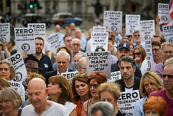 © Licensed to London News Pictures. 19/07/2018. London, UK. Members of the Jewish community, Jewish leaders and supporters hold a demonstration outside the Houses of Parliament in London against Labour's new code of conduct on anti-Semitism. Large parts of the Jewish community have complained about Labour not meeting the Holocaust Remembrance Alliance definition on anti-semitism. Labour MP Dame Margaret Hodge recently confronted Labour leader Jeremy Corbyn over the party's handling of the issue.  Photo credit: Ben Cawthra/LNP