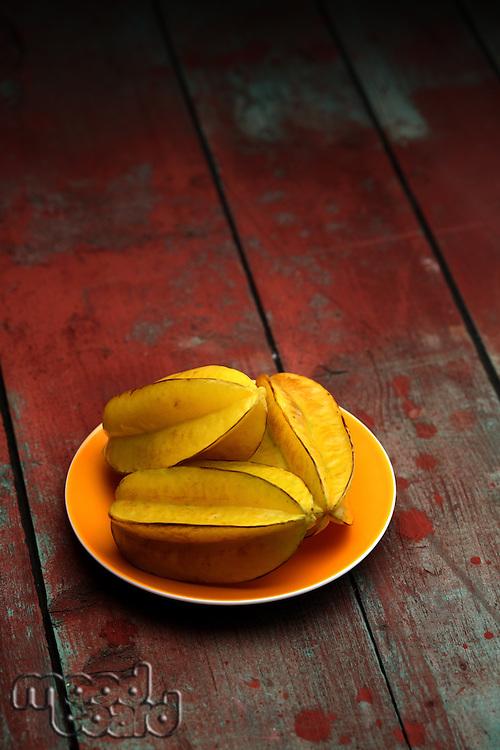 Carambola fruit on wooden background