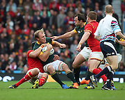 South Africa's Schalk Burger getting tackled after a period of South African pressure during the Rugby World Cup Quarter Final match between South Africa and Wales at Twickenham, Richmond, United Kingdom on 17 October 2015. Photo by Matthew Redman.