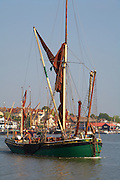 "Great Britain England Essex Maldon River Blackwater Hythe Quay Traditional Thames Sailing Barges tied up at Quay.  ""Kitty"" Thames Sailing Barge leaving on the high tide"