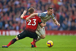 MANCHESTER, ENGLAND - Sunday, February 24, 2019: Manchester United's Luke Shaw (L) and Liverpool's captain James Milner during the FA Premier League match between Manchester United FC and Liverpool FC at Old Trafford. (Pic by David Rawcliffe/Propaganda)