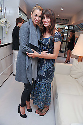 Left to right, ASSIA WEBSTER and LISA BILTON at the opening of the new Melissa Odabash store in Walton Street, London SW3 on 7th July 2011.