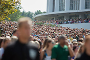 New students leave the Convocation Center as they prepare to march up Richland Avenue to the College Green on Aug. 24, 2014. Photo by Lauren Pond