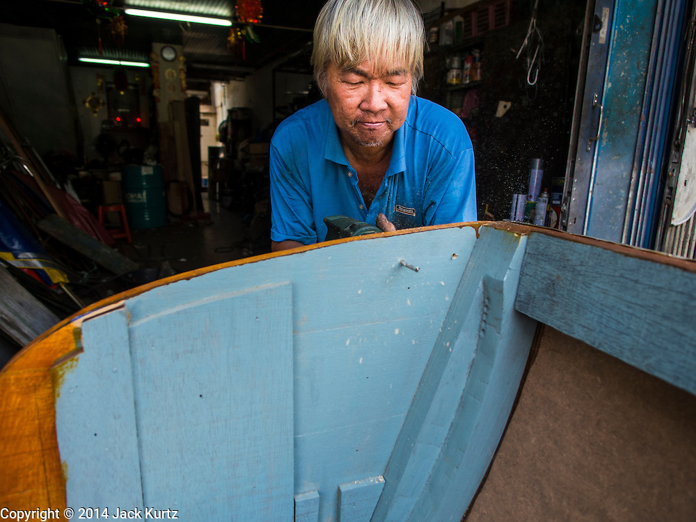 08 OCTOBER 2014 - GEORGE TOWN, PENANG, MALAYASIA: A craftsman makes pedicabs in his workshop in George Town (also Georgetown), the capital of the state of Penang in Malaysia. Pedicabs are still used to get around George Town. Named after Britain's King George III, George Town is located on the north-east corner of Penang Island. The inner city has a population of 720,202 and the metropolitan area known as George Town Conurbation which consists of Penang Island, Seberang Prai, Kulim and Sungai Petani has a combined population of 2,292,394, making it the second largest metropolitan area in Malaysia. The inner city of George Town is a UNESCO World Heritage Site and one of the most popular international tourist destinations in Malaysia.      PHOTO BY JACK KURTZ