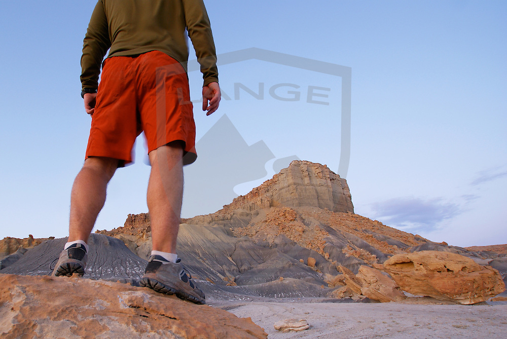 nature scenery and inspiring people: man standing watching the twilight come to desert sandstone landscape, nipple bench, grand staircase escalante national monument, southern utah, usa, horizontal, wide angle, anonymous crop, low angle