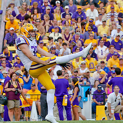 Oct 12, 2013; Baton Rouge, LA, USA; LSU Tigers punter Jamie Keehn (38) punts against the Florida Gators during the second half of a game at Tiger Stadium. LSU defeated Florida 17-6. Mandatory Credit: Derick E. Hingle-USA TODAY Sports