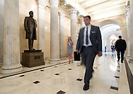 People walk by the James Harlan statue in the Hall of Columns in the United States Capitol building in Washington, D.C. on Thursday, June 23, 2011.
