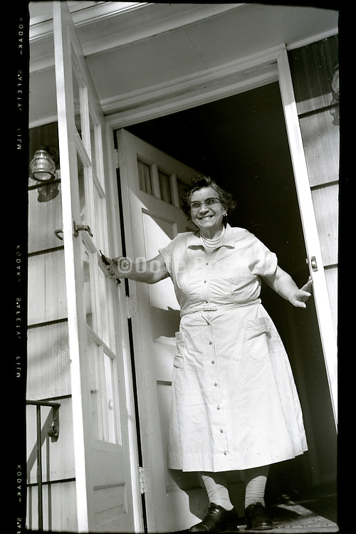 happy smiling grandmother in door opening