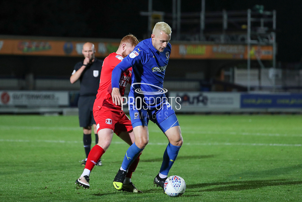 AFC Wimbledon striker Joe Pigott (39) battles for possession and ref blowing whistle in background during the Leasing.com EFL Trophy match between AFC Wimbledon and Leyton Orient at the Cherry Red Records Stadium, Kingston, England on 8 October 2019.