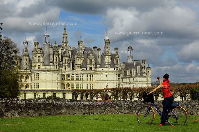 The royal Chateau de Chambord (Chambord, Loir-et-Cher, France) is one of the most recognizable chateaux in the world because of its very distinct French Renaissance architecture that blends traditional French medieval forms with classical Italian structures. It is famous for its central double-helix staircase and the elaborated roof line composed by towers and chimneys. Chambord is the largest castle in the Loire Valley, but was built to serve only as a hunting lodge for François I, who maintained his royal residences at Chateau de Blois and at Chateau d'Amboise.  With the chateau nearing completion, François showed off his enormous symbol of wealth and power by hosting at Chambord his old archnemesis, Emperor Charles V. It is also suggested that Leonardo da Vinci was responsible for the original design, which reflects Leonardo's plans for a chateau at Romorantin for the King's mother, and his interests in central planning and double helical staircases.