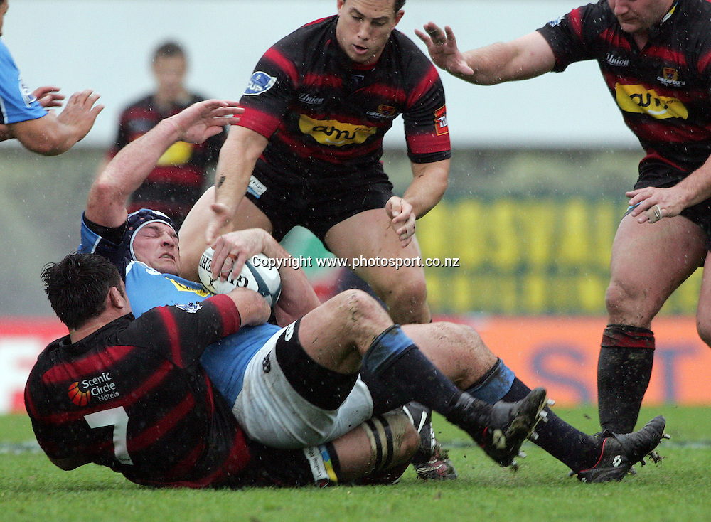 Joel McKenty is tackled by Johnny Leo'o during the Air New Zealand Cup rugby union match between Northland and Canterbury at ITM Stadium, Whangarei, New Zealand on Saturday 5 August, 2006. Canterbury won the match 25 - 11. Photo: Hannah Johnston/PHOTOSPORT<br />