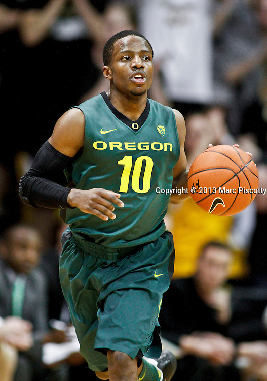SHOT 3/7/13 8:09:37 PM - Oregon's Johnathan Loyd #10 pushes the ball up court against Colorado during their Pac-12 Conference regular season basketball game at the Coors Events Center on the University of Colorado campus in Boulder, Co. Colorado won the game 76-53..(Photo by Marc Piscotty / © 2013)