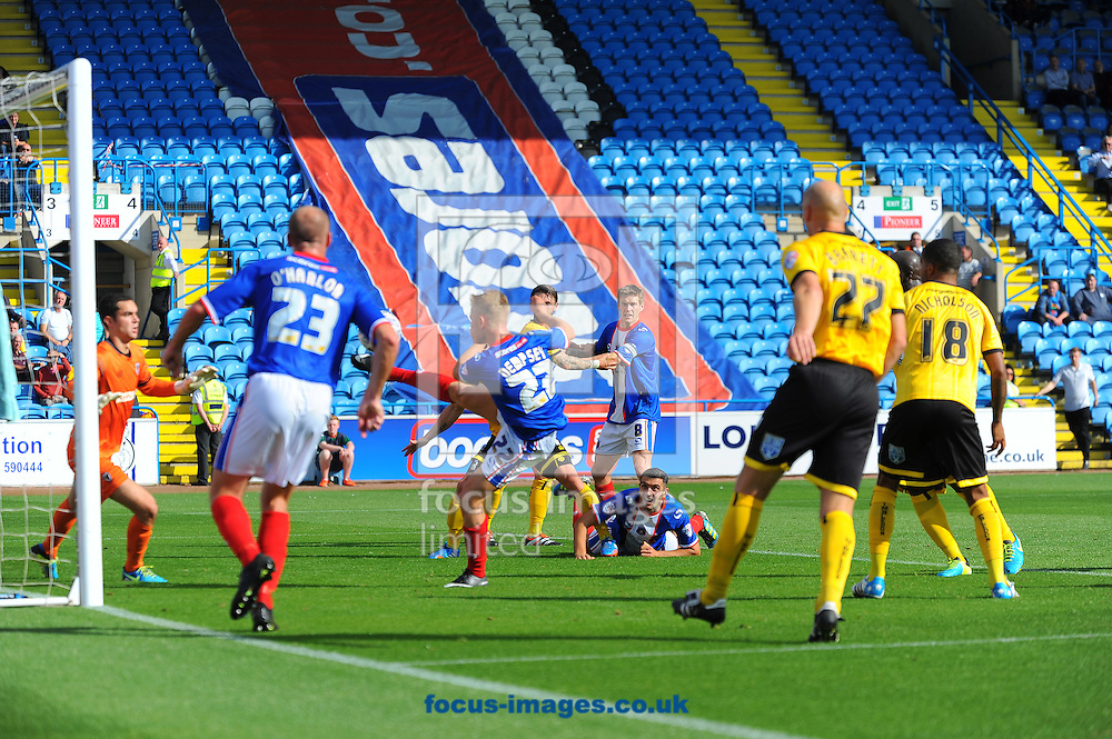 Kyle Dempsey of Carlisle United (centre, number 22) scores his team's second goal during the Sky Bet League 2 match at Brunton Park, Carlisle<br /> Picture by Greg Kwasnik/Focus Images Ltd +44 7902 021456<br /> 06/09/2014