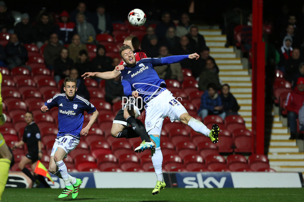 Cardiff City midfielder, Anthony Pilkington (13) battling for ball with Brentford defender, Jake Bidwell (3) during the Sky Bet Championship match between Brentford and Cardiff City at Griffin Park, London, England on 19 April 2016. Photo by Matthew Redman.