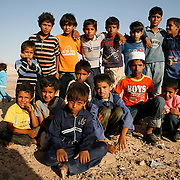Bedouin boys are gathering together at the Bedouin wedding near Petra, Jordan