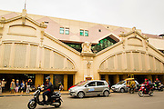 01 APRIL 2012 - HANOI, VIETNAM:  The main entrance to Dong Xuan Market, one of the largest markets in Hanoi, the capital of Vietnam. The market The market was originally built by French colonial authorities in 1889. It was renovated in 1990 but burnt to the ground in 1994. The present building was built in 1996.    PHOTO BY JACK KURTZ