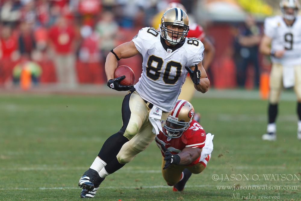 Jan 14, 2012; San Francisco, CA, USA; New Orleans Saints tight end Jimmy Graham (80) rushes past San Francisco 49ers inside linebacker NaVorro Bowman (53) during the third quarter of the 2011 NFC divisional playoff game at Candlestick Park. San Francisco defeated New Orleans 36-32. Mandatory Credit: Jason O. Watson-US PRESSWIRE