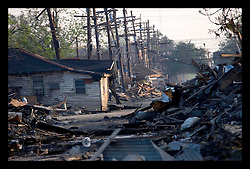 30th Sept, 2005. Hurricane Katrina aftermath, New Orleans, Louisiana. Lower 9th ward. The remnants of the lives of ordinary folks, now covered in mud as the flood waters recede. The battered remains of the streets.
