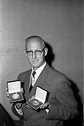 20/07/1962<br /> 07/20/1962<br /> 20 July 1962<br /> Mr George P.M. Vitty, export Sales Manager with Williams and Woods, 26 King's Inns Street, Dublin,  shows some of the awards the company had won for its chocolate making.