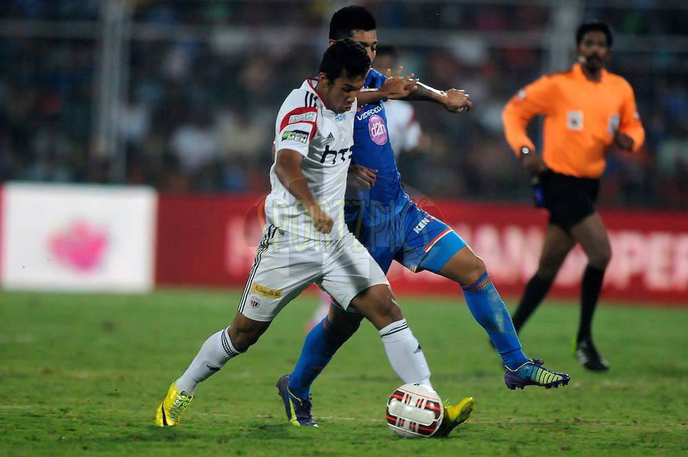 Alen Deory of NorthEast United FC and Haroon Fakhruddin of FC Goa during match 46 of the Hero Indian Super League between FC Goa and North East United FC held at the Jawaharlal Nehru Stadium, Fatorda, India on the 1st December 2014.<br /> <br /> Photo by:  Pal Pillai/ ISL/ SPORTZPICS