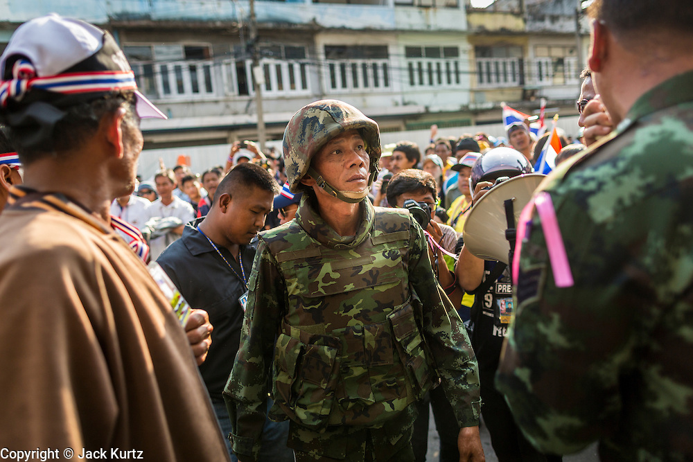 17 JANUARY 2014 - BANGKOK, THAILAND: Thai soldiers arrive at the abandoned building anti-government protestors believe was used to launch an IED attack on them. The attackers were not found but officials claim to have found a weapons cache in an abandoned building nearby. Friday was day 5 of the anti-government Shutdown Bangkok protests. The protest, led by the People's Democratic Reform Committee, is calling for the suspension of elections pending political reform in Thailand. There was violence at several sites in Bangkok Friday, including running battles between government opponents and supporters at one site and an IED attack by unknown assailants on anti-government protestors at another site.    PHOTO BY JACK KURTZ