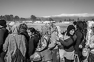 19 April 2016, Greece, Idomeni - Women Refugees wait in line for the food.