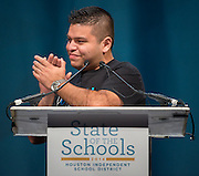 Young Men's College Preparatory Academy science teacher Adrian Acosta acknowledges his mentor during his comments at the Houston ISD State of the Schools luncheon at the Hilton of the Americas, February 26, 2014.