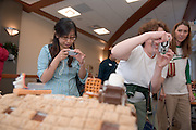 The Baker Food Court is hosting a Gingerbread Competition..Jewell Barlow(middle).E-ling Hsiao(left)..And Sarah Rist(right(