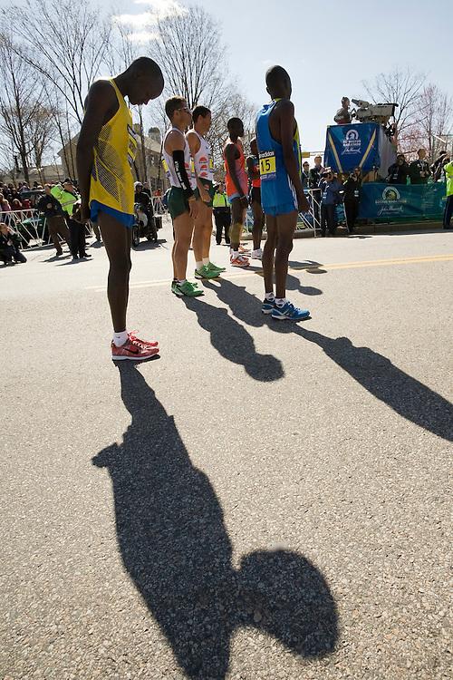elite men runners pause for national anthem