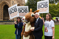 "Nature campaigners accompanied by a  giant red squirrel, Bob, urge MPs to ""Vote For Bob"" during a photocall outside Parliament. Their aim is to get MPs to support nature in Britain. PICTURED: Sir Bob Russel MP holding a box of ""Bob's biscuits"" poses with campaigners outside Parliament."