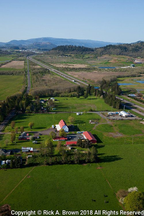 I5 running through farmland in the Southern Willamette Valley.