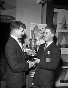 23/04/1960<br /> 04/23/1960<br /> 23 April 1960<br /> Coca-Cola Canoe racing trophy presented. The Coca-Cola Perpetual trophy of Open Handicap Canoe Racing was presented to Mr Roger Greene of Sandymount, Co. Dublin at the conclusion of the 1st Irish Boat Week. Mr Greene, a member of the  Dun Laoghaire Canoe Club, in a canoe race on the river Liffey. Picture shows Mr. Brendan Kelly (left) of Beverage Distributers Ltd. presenting the Coca-Cola trophy to Roger Greene at the Irish Boat Show.