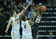 December 28, 2011: Purdue Boilermakers guard Lewis Jackson (23) tries to shoot over Iowa Hawkeyes forward Zach McCabe (15) and Iowa Hawkeyes guard/forward Roy Devyn Marble (4) during the NCAA basketball game between the Purdue Boilermakers and the Iowa Hawkeyes at Carver-Hawkeye Arena in Iowa City, Iowa on Wednesday, December 28, 2011. Purdue defeated Iowa 79-76.