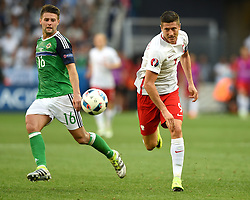 Robert Lewandowski of Poland battles for the ball with Oliver Norwood of Northern Ireland  - Mandatory by-line: Joe Meredith/JMP - 12/06/2016 - FOOTBALL - Stade de Nice - Nice, France - Poland v Northern Ireland - UEFA European Championship Group C