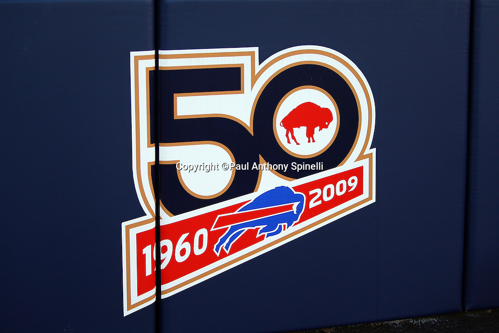 The Buffalo Bills 50 year logo is painted on the pads lining the field during the NFL football game against the Houston Texans, November 1, 2009 in Orchard Park, New York. The Texans won the game 31-10. (©Paul Anthony Spinelli)