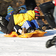 Boys sledding in Central Park after New York City was hit with over 7 inches of snow during its first winter storm of the year. Central Park, Manhattan, New York, USA. 4th January 2014 Photo Tim Clayton