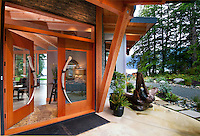 The ocean-side home of Nolan and Sandy Fisher features views of the open water from most rooms.