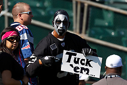 Oct 2, 2011; Oakland, CA, USA; Oakland Raiders fan in the stands with a sign before the game against the New England Patriots at O.co Coliseum. Mandatory Credit: Jason O. Watson-US PRESSWIRE