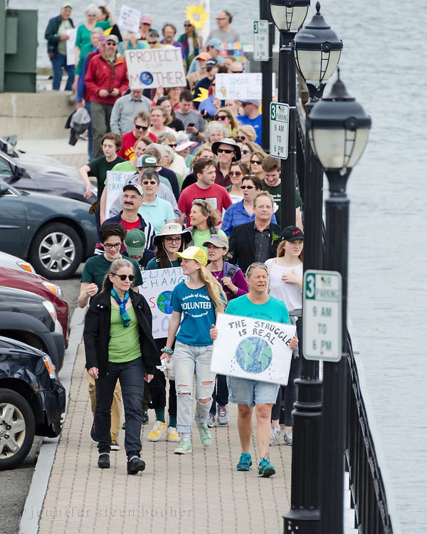 Bar Harbor, USA. 29 April, 2017. Protesters in the Downeast Climate March, a sister march to the People's Climate March in Washington, D.C., join hands for a Circle of Silence on the Bar Harbor Town Pier.